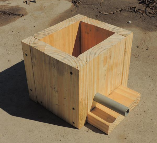 Bumblebee nesting box made from lumber and a PVC pipe