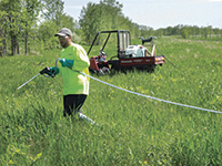 Herbicide being applied in the field to remove unwanted or invasive vegetation from the area.